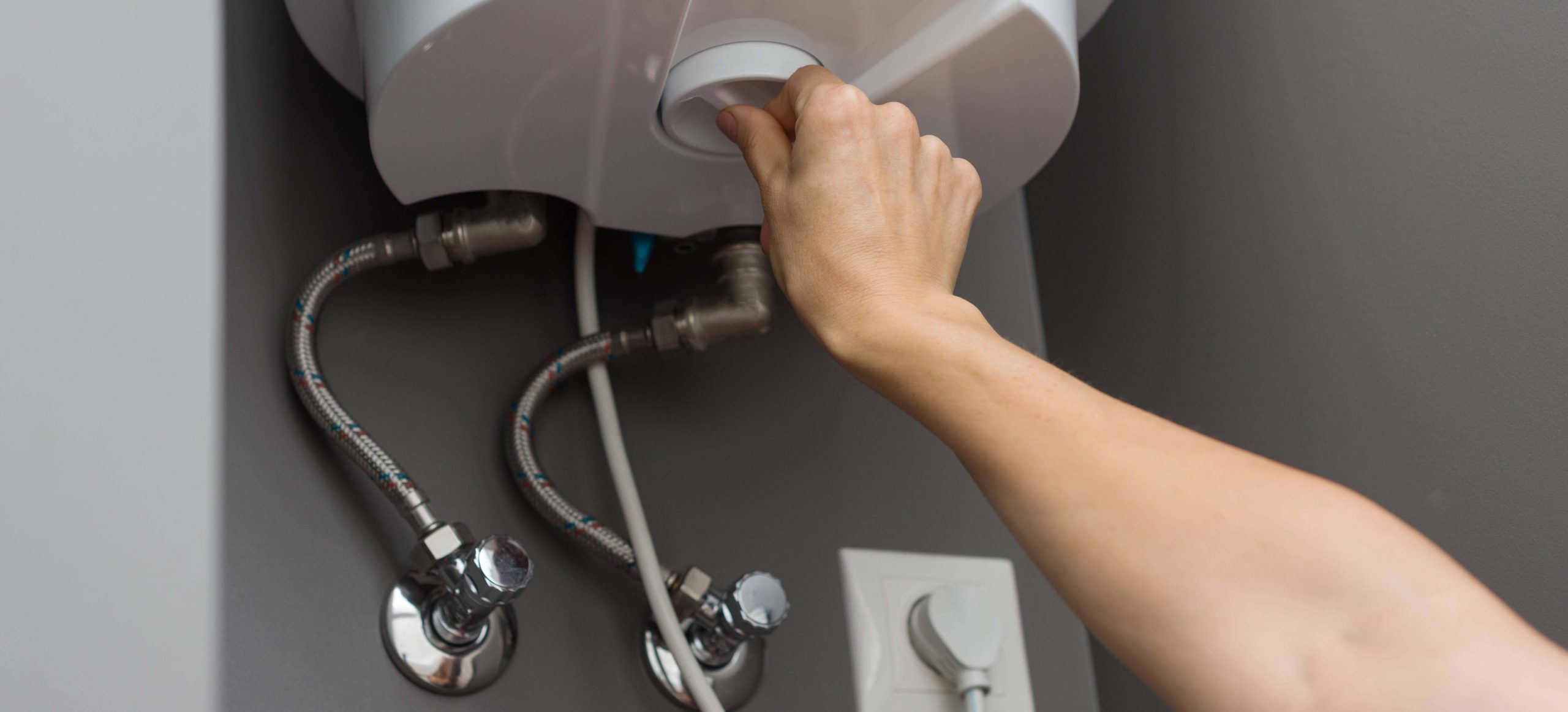 A photo of a woman choosing a hot water heater