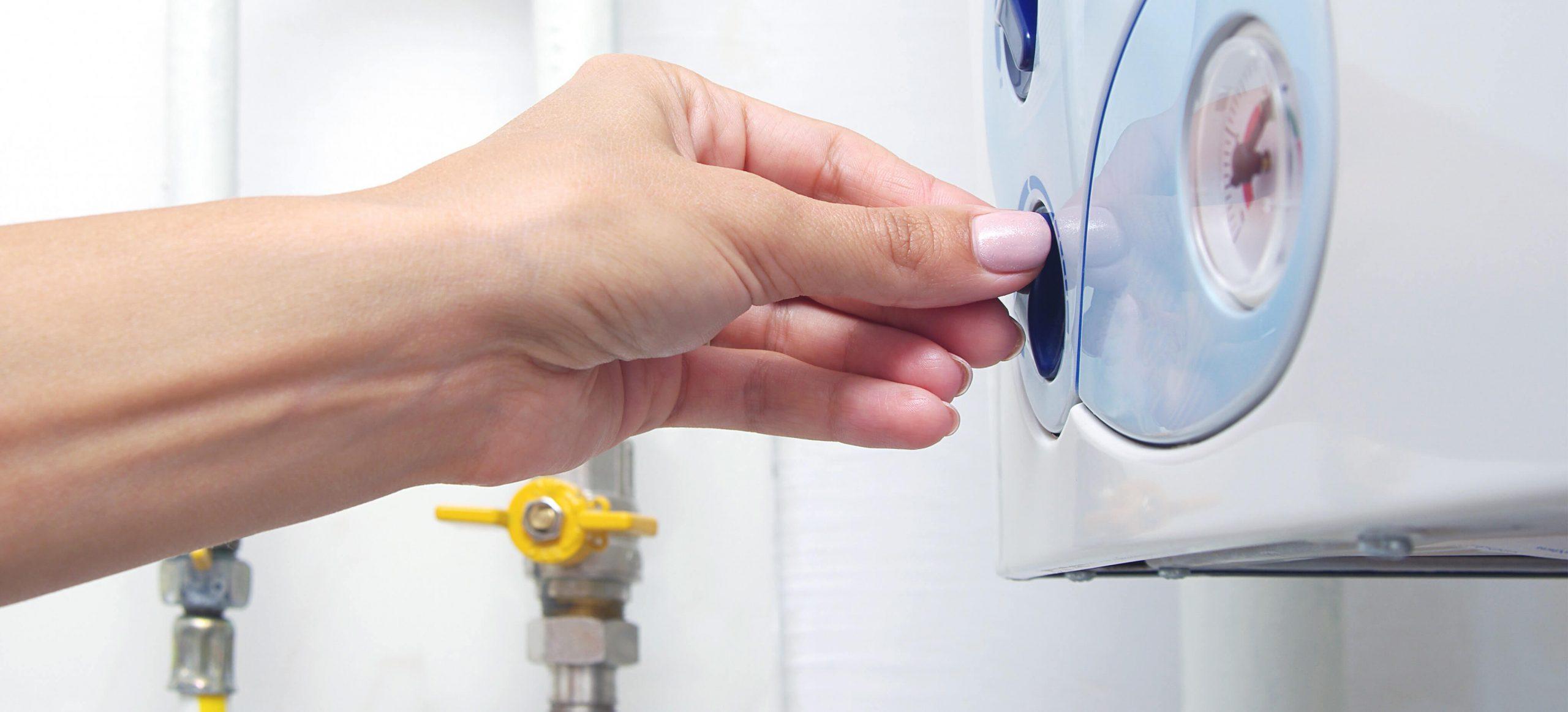 A woman tries to start a boiler that's not firing up