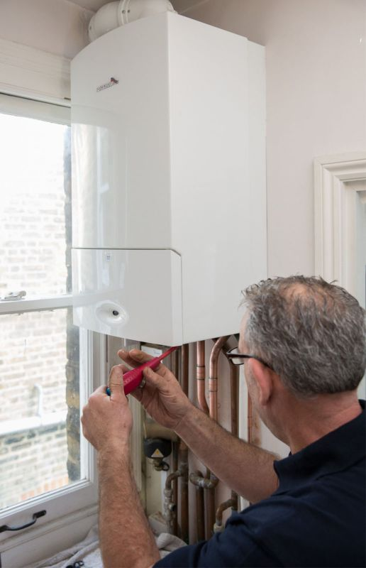 Gas Safe-registered engineer inspecting a boiler